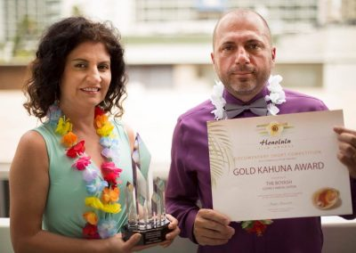 Daniela Apostoaei (left) and Codrut Miron (right) holding awards in Honolulu, HI