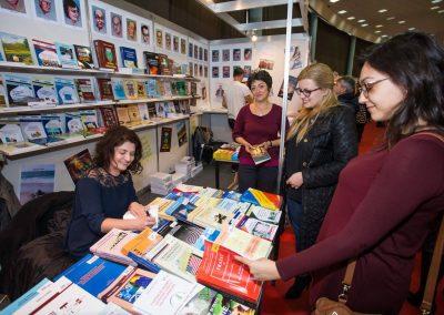 Daniela Cupse Apostoaei signing the book Blue Embrace