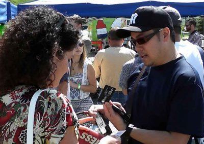 Daniela Apostoaei dialogue with the carpenter of the Omikoshe Shrine at the Omatsuri Festival in Calgary
